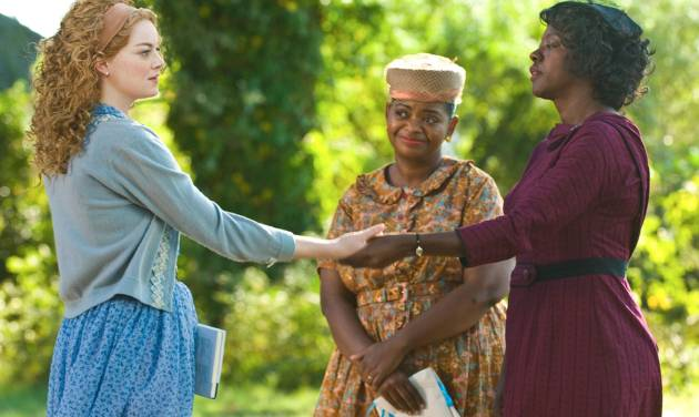 """File - In this undated file film publicity image released by Disney, from left, Emma Stone, Octavia Spencer and Viola Davis are shown in a scene from """"The Help."""" """"The Help"""" continues to clean up at the box office, taking over the No. 1 spot with $20.5 million in its second weekend. (AP Photo/Disney, Dale Robinette, File)"""