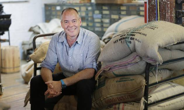 In this July 14, 2014 photo, Jim Munson, owner of Brooklyn Roasting Company, poses for photos in New York. Sales of the company's Free Trade coffee have soared from $900,000 in 2011 to $4.4 million last year, and are expected to reach $6 million in 2014. (AP Photo/Seth Wenig)