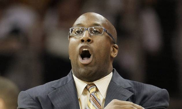 FILE - In this May 11, 2011, file photo, Cleveland Cavaliers coach Mike Brown signals his team in the third quarter of Game 5 against the Boston Celtics in a second-round NBA basketball playoff series in Cleveland. Brown is back as Cleveland's head coach after being fired by the Cavaliers three years ago. (AP Photo/Tony Dejak, File)