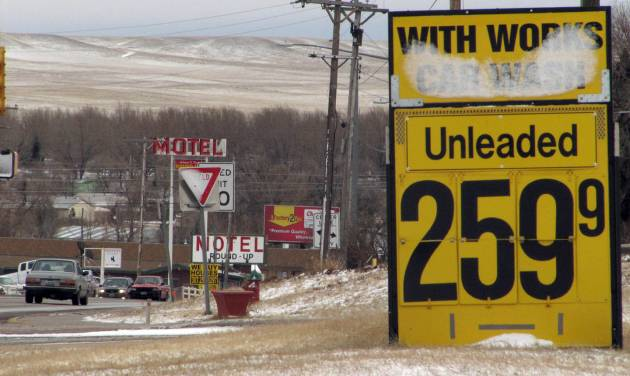 This Wednesday, Jan. 30, 2013 photo shows a sign outside a gas station in Cheyenne, Wyo., that advertises some of the least expensive gasoline to be found anywhere in the United States. According to AAA, Wyoming has the nation's cheapest gasoline, due to its low fuel taxes and a regional abundance of crude oil from Canada and North Dakota. (AP Photo/Mead Gruver)