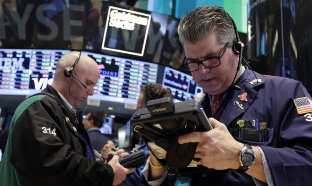 FILE - In this April 30, 2014 file photo, traders Kevin Walsh, left, and John Panin work on the floor of the New York Stock Exchange. Stocks are edging higher in early trading Thursday, May 8, 2014, after investors were mostly pleased by the latest U.S. corporate earnings news.  (AP Photo/Richard Drew, File)