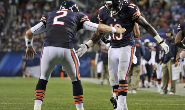 Chicago Bears wide receiver Joe Anderson (19) celebrates his touchdown reception with quarterback Jordan Palmer (2) during the first half of a preseason NFL football game against the Cleveland Browns, Thursday, Aug. 29, 2013, in Chicago. (AP Photo/Jim Prisching)