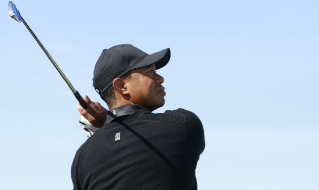 Tiger Woods of the US plays a shot on the 13th hole during a practice round ahead of the British Open Golf championship at the Royal Liverpool golf club, Hoylake, England, Tuesday July 15, 2014. The British Open starts on Thursday July 17. (AP Photo/Peter Morrison)
