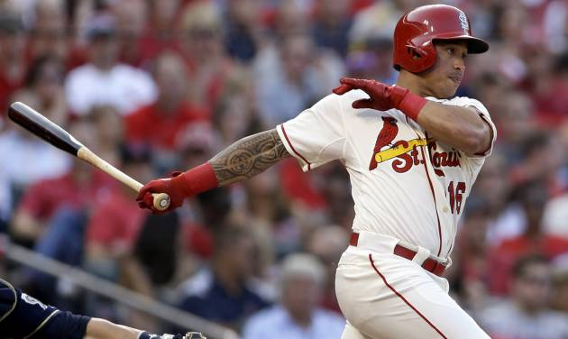 St. Louis Cardinals' Kolten Wong follows through on a two-run single during the second inning of a baseball game against the Milwaukee Brewers Saturday, Aug. 2, 2014, in St. Louis. (AP Photo/Jeff Roberson)