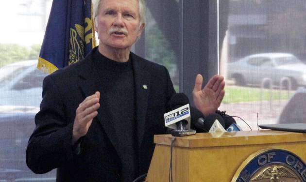 In this Nov. 1, 2013 file photo, Oregon Gov. John Kitzhaber discusses problems with the website for Cover Oregon, the state's health insurance exchange, during a news conference in Portland, Ore. More than a month after Cover Oregon was supposed to launch, reality is lagging far behind Gov. Kitzhaber's ideals. The online system still doesn't work, and the exchange has yet to enroll a single person in health insurance. Interviews with state officials and a review of public records suggests Cover Oregon officials bit off more than they could chew and clung stubbornly to their ambitious vision even when their risk management consultants raised alarms. (AP Photo/Jonathan J. Cooper, File)