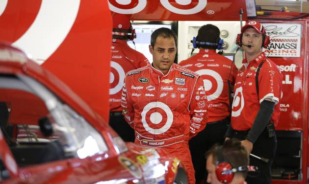 Juan Pablo Montoya, center, of Colombia, watches his crew work on his car as they prepare for practice at the NASCAR Sprint Cup Series auto race Friday, June 21, 2013, in Sonoma, Calif. (AP Photo/Ben Margot)