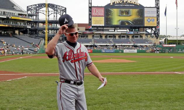 Altanta Braves Chipper Jones walks to the dugout after presenting the lineup card before a baseball game against the Pittsburgh Pirates at PNC Park in Pittsburgh Wednesday, Oct. 3, 2012. (AP Photo/Gene J. Puskar)