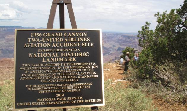 A plaque marking the designation of a 1956 commercial airliner collision over the Grand Canyon in northern Arizona is displayed on Tuesday, July 8, 2014. About 200 people gathered at the canyon to attend the unveiling of the plaque. (AP Photo/Felicia Fonseca)