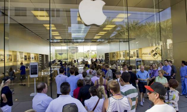 FILE- In this Wednesday, Oct. 19, 2011, file photo, a line of customers enter an Apple store in Scottsdale, Ariz. Delivery times climbed quickly as Apple Inc. started taking orders for the iPhone 5 on Friday, Sept. 14, 2012, suggesting strong demand. (AP Photo/Matt York, File)