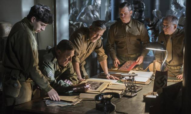 "This image released by Columbia Pictures shows Dimitri Leonidas, John Goodman, George Clooney, Matt Damon and Bob Balaban in ""The Monuments Men."" (AP Photo/Columbia Pictures, Claudette Barius)"