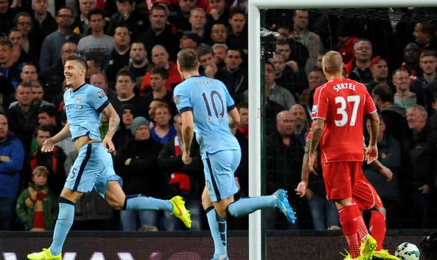 Manchester City's Stevan Jovetic, left, celebrates after scoring against Liverpool during the English Premier League soccer match between Manchester City and Liverpool at the Etihad Stadium, in Manchester, England, Monday, Aug. 25, 2014. (AP Photo/Rui Vieira)