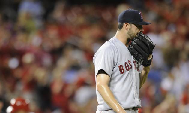 Boston Red Sox's starting pitcher Brandon Workman, right, walks off the mound after giving up a solo home run to St. Louis Cardinals' Kolton Wong, rear, in the fifth inning in a baseball game, Thursday, August 7, 2014, at Busch Stadium in St. Louis. (AP Photo/Bill Boyce)