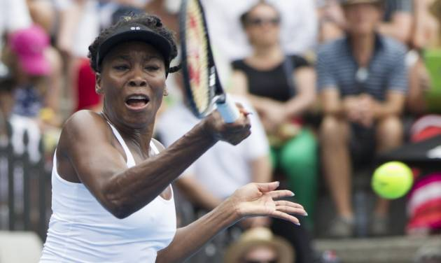 Venus Williams of the U.S. plays a shot against Serbia's Ana Ivanovic in the singles final at the ASB Classic women's tennis tournament at ASB Tennis Arena, in Auckland, New Zealand, Saturday, Jan. 4, 2014. (AP Photo/SNPA, David Rowland) NEW ZEALAND OUT