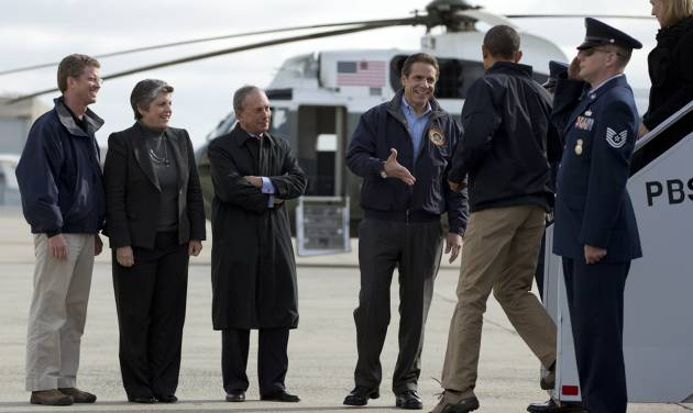 New York Gov. Andrew Cuomo greets President Barack Obama as he arrives at JFK International Airport in New York, Thursday, Nov. 15, 2012, before visiting areas devastated by Superstorm Sandy. From left are, Housing and Urban Development Shaun Donovan, Homeland Security Janet Napolitano, and New York City Mayor Michael Bloomberg . (AP Photo/Carolyn Kaster)