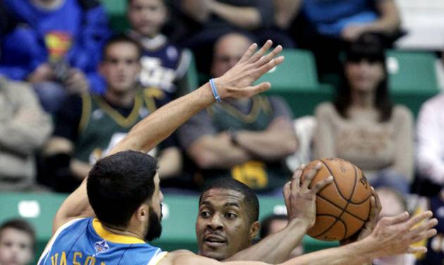 Utah Jazz's Derrick Favors (15) passes the ball against New Orleans Hornets' Greivis Vasquez (21), of Venezuela, in the first quarter during an NBA basketball game Wednesday, Jan. 30, 2013, in Salt Lake City. (AP Photo/Rick Bowmer)