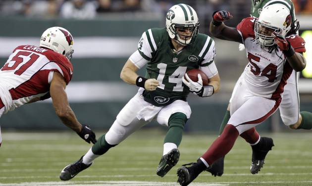 New York Jets quarterback Greg McElroy (14) runs with the ball as Arizona Cardinals inside linebacker Paris Lenon (51) and outside linebacker Quentin Groves (54) defend during the second half of an NFL football game on Sunday, Dec. 2, 2012, in East Rutherford, N.J. The Jets won 7-6. (AP Photo/Kathy Willens)