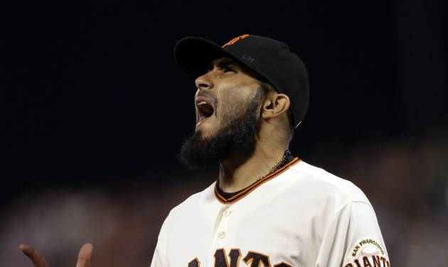 San Francisco Giants reliever Sergio Romo celebrates after retiring the side during the ninth inning of a baseball game against the Arizona Diamondbacks on, Tuesday, Sept. 4, 2012 in San Francisco. (AP Photo/Marcio Jose Sanchez)