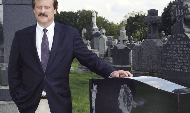 """FILE - In this Oct. 1, 2006 file photo, author William B. Styple poses next to the grave of Civil War artist-writer James Edward Kelly at a cemetery in New York. Styple's latest book, """"McClellan's Other Story"""", focuses on the role of a Cincinnati politician as adviser to Union Gen. George McClellan, who ran against Abraham Lincoln for president in 1864. Long before Mitt Romney and Barack Obama wrestled over Ohio, it was a political battleground state for Lincoln. (AP Photo/Rick Maiman, File)"""