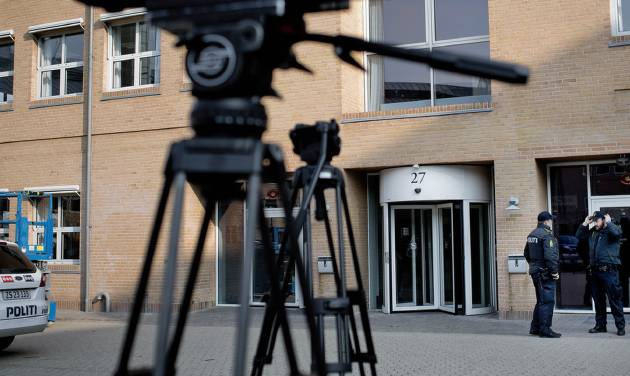 Danish Police secure the area outside the court, as camera tripods stand testament to the large media interest outside the court in Copenhagen, Denmark, Friday April 13, 2012, prior to the start of a court case against four men accused of terrorism and illegal possession of weaponry. The terror trial of four Swedes accused of plotting a revenge attack on Danish newspaper Jyllands-Posten that printed caricatures of the Prophet Muhammad, started Friday in Denmark, with a heavily armed police presence. (AP PHOTO/POLFOTO, Magnus Holm) DENMARK OUT