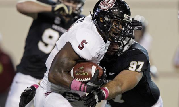 Massachusetts running back Michael Cox (5) is tackled by Vanderbilt defensive tackle Jared Morse (97) during the first quarter of an NCAA college football game Saturday, Oct. 27, 2012, in Nashville, Tenn. (AP Photo/Wade Payne)