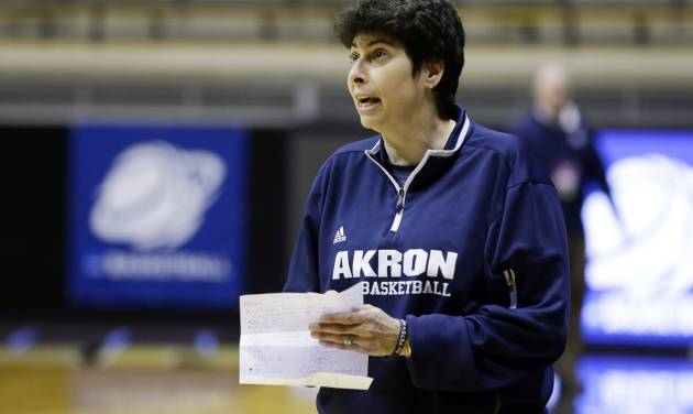 Akron head coach Jodi Kest yells to her team during during practice at the NCAA women's college basketball tournament in West Lafayette, Ind., Friday, March 21, 2014.  Akron plays Purdue in a first-round game on Saturday. (AP Photo/Michael Conroy)