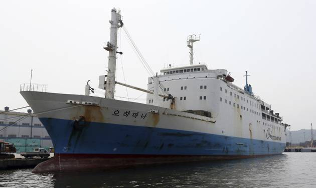 In this June 19, 2014 photo, Ohamana, a Chonghaejin Marine Co., car ferry that plied the same route as the sunken Sewol, drops anchor at Incehon port, South Korea. The company that operated the doomed South Korean ferry that sank in April had a questionable safety record throughout its history, marred by frequent maritime accidents followed by sanctions from authorities. Chonghaejin Marine Co. sailors or upper-level managers were found to be the primary cause of at least five crashes between 2003 and this year. (AP Photo/Yonhap)  KOREA OUT