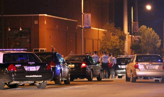 Police investigate a scene of shooting with multiple victims near Reno Avenue and Mickey Mantle Drive following the Oklahoma City vs. Los Angeles NBA playoff game early morning, Tuesday, May 22, 2012 in Oklahoma City. Oklahoma City police say at least eight people were shot late Monday blocks from Chesapeake Energy Arena after the NBA playoff game between the Thunder and the Los Angeles Lakers. (AP Photo/The Oklahoman, Sarah Phipps) TABLOIDS OUT