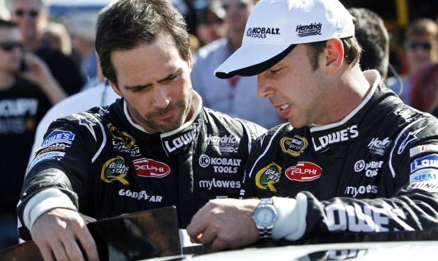 "FILE - In this Nov. 11, 2012 file photo, Jimmie Johnson, left, talks with crew chief Chad Knaus prior to the NASCAR Sprint Cup Series auto race at Phoenix International Raceway in Avondale, Ariz. When asked about how dominating the pair has been since they partnered in 2002, the relentless Knaus replied: ""We lose a heck of a lot more races than we win.""  (AP Photo/Ross D. Franklin, File)"