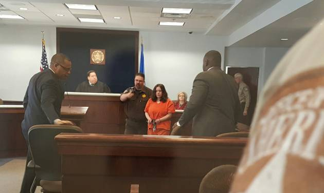 Murder defendant Adacia Avery Chambers is escorted into a Payne County courtroom Feb. 16 for a brief hearing. The 25-year-old woman is accused of driving her car into a crowd at the 2015 Oklahoma State University homecoming parade. Four spectators died and dozens more were injured.   Photo by Kyle Schwab, The Oklahoman