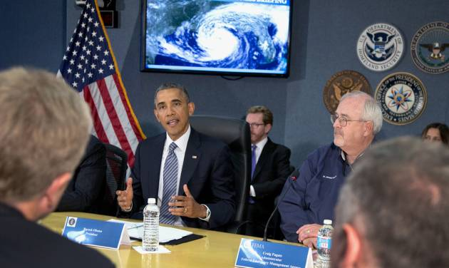 President Barack Obama speaks at Federal Emergency Management Agency (FEMA) headquarters in Washington, Friday, May 30, 2014, during a hurricane preparedness meeting. at right is Federal Emergency Management Agency (FEMA) administrator Craig Fugate. (AP Photo/Carolyn Kaster)