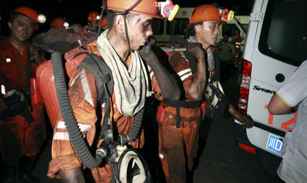 In this photo released by China's Xinhua News Agency, rescuers work at Xiaojiawan Coal Mine in Panzhihua City, southwest China's Sichuan Province, Thursday, Aug. 30, 2012. A gas explosion at the mine killed over a dozen miners and trapped dozens more, state media reported Thursday. (AP Photo/Xinhua, Zhang Zhong) NO SALES