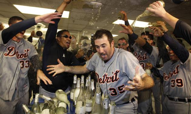 Detroit Tigers' Justin Verlander (35) is drenched with sparkling wine by teammates at the end of Game 5 of during the American League division baseball series in Oakland, Calif., Thursday, Oct. 11, 2012. (AP Photo/Ben Margot)