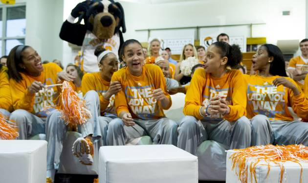 Tennessee's Andraya Carter, center, is surprised and congratulated by teammates as she was showcased on the NCAA selection show at the Women's Basketball Hall of Fame in Knoxville, Tenn. on Monday, March 17, 2014. Tennessee received a no. 1 seed in the Louisville Regional of the NCAA Tournament.  (AP Photo/The Knoxville News Sentinel, Saul Young)
