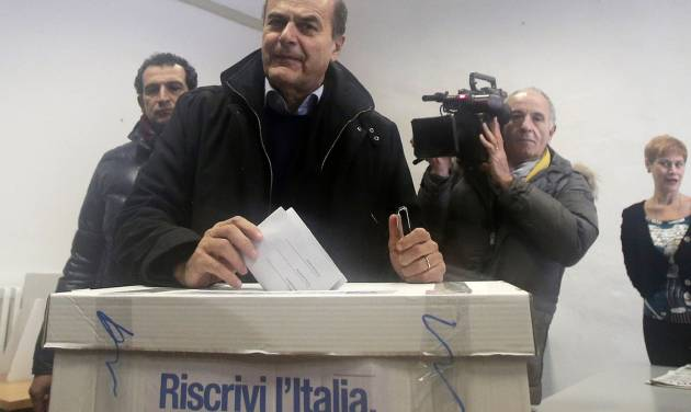 "Pier Luigi Bersani, leader of the center-left Democratic Party, casts his vote during a primary runoff, in Piacenza, Italy, Sunday, Dec. 2, 2012. Italians are choosing a center-left candidate for premier for elections early next year, an important primary runoff given the main party is ahead in the polls against a center-right camp in utter chaos over whether Silvio Berlusconi will run again. Sunday's runoff pits veteran center-left leader Pier Luigi Bersani, 61, against the 37-year-old mayor of Florence, Matteo Renzi, not shown, who has campaigned on an Obama-style ""Let's change Italy now"" mantra. (AP Photo/Antonio Calanni)"