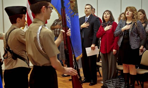 James Robert Kalsu Jr., son, Jan Kalsu Mclauchlin, widow, and Jill Kalsu-Horning, daughter, from left, salute the American Flag during the detection ceremony to rename the Del City post office after their fallen father and husband, 1st Lt. James Robert Kalsu, on Friday, Feb. 5, 2016, in Del City, Okla. Kalsu a former Del City resident who played football at the University of Oklahoma, and for the Buffalo Bills before serving the United States in Vietnam where he lost his life in the line of duty. Photo by Chris Landsberger, The Oklahoman