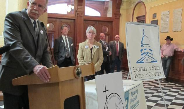 Dr. Brent Sherard, left, spokesman for the Wyoming Integrated Care Network, speaks in favor of expanding the federal Medicaid system on Tues., Jan. 22, 2013, at the State Capitol in Cheyenne, Wyo. The network is part of a coalition of groups that supports the expansion, which is pending before the Wyoming Legislature. (AP Photo/Ben Neary)