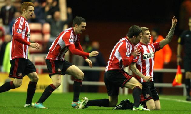 Sunderland's James McClean, right, celebrates his goal with his teammates during their English Premier League soccer match against Reading at the Stadium of Light, Sunderland, England, Tuesday, Dec. 11, 2012. (AP Photo/Scott Heppell)