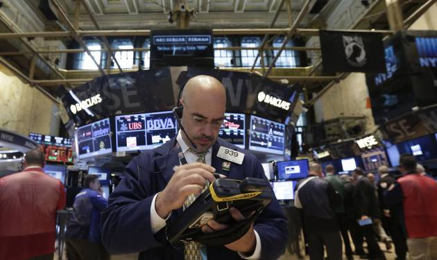 Trader Luigi Muccitelli works on the floor of the New York Stock Exchange Monday, June 23, 2014. Stocks are edging lower in early trading after indexed closed last week at record highs. (AP Photo/Richard Drew)