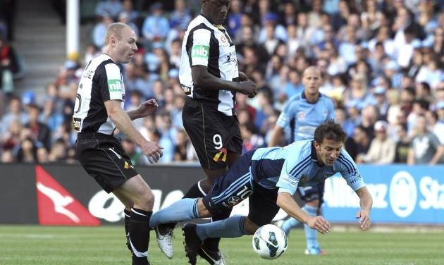 Sydney FC's Alessandro Del Piero, right, falls after being tackled by Newcastle Jets' Craig Goodwin, left, and Emile Heskey during their A-league soccer match in Sydney, Australia, Saturday, Oct. 13, 2012. (AP Photo/Rob Griffith)