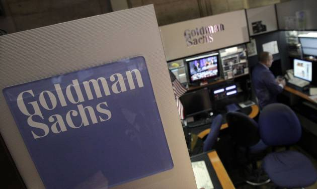FILE - In this March 15, 2012 file photo, a trader works in the Goldman Sachs booth on the floor of the New York Stock Exchange. Goldman Sachs will report first quarter earnings later Thursday April 17, 2014 (AP Photo/Richard Drew, File)