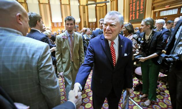 Georgia Gov. Nathan Deal, center, walks with his escorts as he shakes hands with legislators as he leaves the House Chambers after delivering the State of the State address in the Georgia State Capitol Thursday, Jan. 17, 2013, in Atlanta.  (AP Photo/Atlanta Journal-Constitution, Jason Getz  )  MARIETTA DAILY OUT; GWINNETT DAILY POST OUT; LOCAL TV OUT; WXIA-TV OUT; WGCL-TV OUT