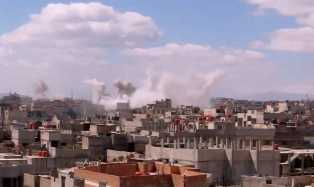 In this image taken from video obtained from the Shaam News Network, which has been authenticated based on its contents and other AP reporting, columns of smoke rise from heavy bombing by Syrian government forces in Arbeen, Syria, Monday March 18, 2013. Two years after the anti-Assad uprising began, the conflict has become a civil war, with hundreds of rebel group fighting Assad's forces across Syria and millions of people pushed from their homes by the violence. The U.N. says more than 70,000 people have been killed. (AP Photo/Shaam News Network via AP video)