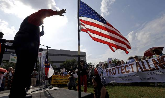 """Rev. William Barber, president of the N.C. chapter of The National Association for the Advancement of Colored People addresses supporters at Halifax Mall outside the state legislature in Raleigh, N.C., Monday, June 17, 2013.   Supporters of what the group calls """"Moral Mondays"""" are outraged over GOP policies that they say restrict voting access, undermine public education and hurt the poor and jobless. More than 80 people are facing criminal charges after the seventh week of protests led by the North Carolina chapter of the NAACP. (AP Photo/Gerry Broome)"""