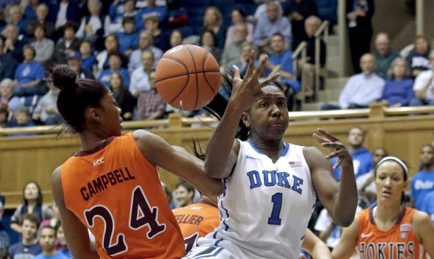 Duke's Elizabeth Williams (1) and Virginia Tech's Taijah Campbell (24) reach for a rebound during the first half of an NCAA college basketball game in Durham, N.C., Wednesday, Jan. 16, 2013. Duke won 58-26. (AP Photo/Gerry Broome)