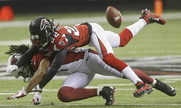 Atlanta Falcons cornerback Asante Samuel (22) breaks up a pass intended for Arizona Cardinals wide receiver Larry Fitzgerald (11) during the first half of an NFL football game Sunday, Nov. 18, 2012, in Atlanta. (AP Photo/John Bazemore)