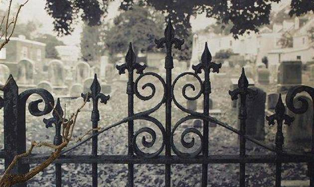 This product image released by Pottery Barn shows their Haunted Gate wall mural featuring a black-and-white photograph of an iron gate opening into a mist-filled graveyard.  This season you'll find lots of ghoulish yet glamorous pieces to decorate with for Halloween.       (AP Photo/Pottery Barn)  NO SALES
