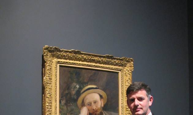 Brian Kennedy, director of the Toledo Museum of Art, poses in front of a portrait of French Impressionist Edouard Manet, Wednesday, Oct. 3, 2012, in Toledo, Ohio. An exhibition of Manet's works opened this month and runs through the end of the year before moving onto the Royal Academy of Arts in London. (AP Photo/John Seewer)