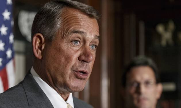 """FILE - This Jan. 28, 2014 file photo shows House John Boehner of Ohio, accompanied by House Majority Leader Eric Cantor of Va. speaking at Republican National Committee headquarters in Washington. House Republican leaders challenged President Barack Obama on Thursday to override the opposition of the Senate's top Democrat and help pass trade legislation the administration favors. """"The president ought to stand up and lead on this issue,"""" House Speaker John Boehner of Ohio said at a news conference at a three-day retreat for members of the party's rank-and-file. (AP Photo/J. Scott Applewhite, File)"""