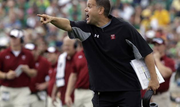 FILE - In this Aug. 31, 2013, file photo, Temple coach Mark Rhule yells to his team during an NCAA college football game against Notre Dame in South Bend, Ind. Rhule shares some of the safety concerns held by Arkansas' Bret Bielema and Alabama's Nick Saban about how hurry-up offenses increase the number of plays per game and don't allow defenses to substitute for fatigued players. Rhule said it's better to be out in front of a potentially dangerous situation than too late. (AP Photo/Michael Conroy, File)