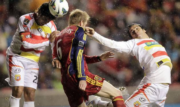 Real Salt Lake's Nat Borchers, center, looks to score under pressure from C.S. Herediano's Pablo Salazar and Cristian Montero during their CONCACAF soccer match, Tuesday, Oct. 23, 2012, in Sandy, Utah. (AP Photo/The Deseret News, Brian Nicholson) SALT LAKE TRIBUNE OUT; PROVO DAILY HERALD OUT; MAGS OUT